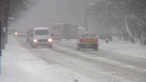 Auto traffic in winter conditions on a road that has not been cleaned of snow an Footage