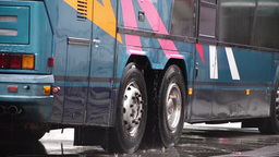 Man washes with a facility pressure wheels and bodywork of a bus 73 Footage