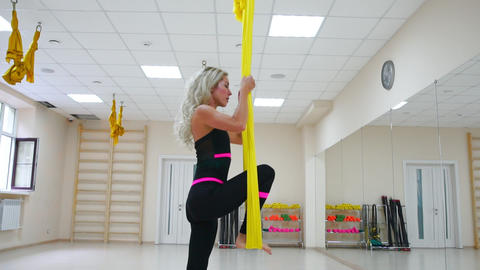 Fly yoga in a white gym. Gymnastics performs physical exercises for fly yoga Footage