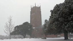 Snowing at English country church St Marys Bishops Lydeard Somerset UK Footage