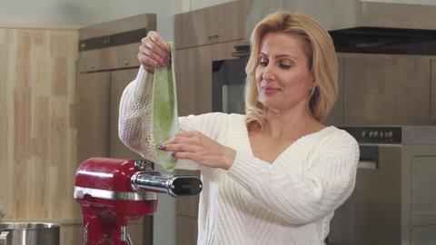 Beautiful mature housewife using pasta machine making homemade pasta 영상물