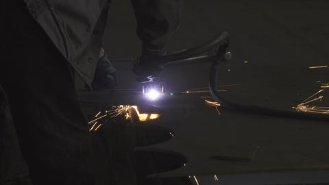 Industry worker in protective uniform cutting metal manually Footage