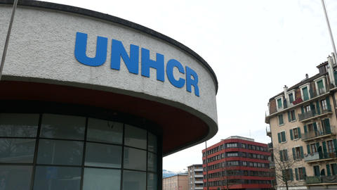 Sign at the main entrance of the UNHCR headquarters in Geneva Live Action