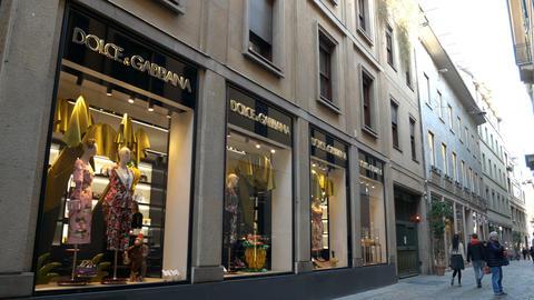 Establishing shot of a fashion store in Via della Spiga in Milan Footage