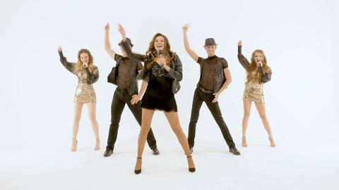 Video shooting of music video. Professional singers and dancers show the musical Footage