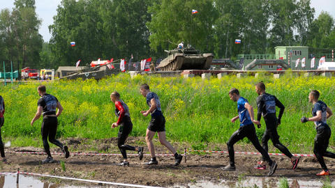 Sportsmen run between stages at the Race of Heroes Live Action