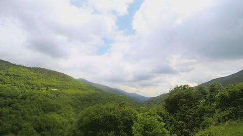 Timelapse Over a Green Valley Stock Video Footage