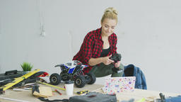Female with radio-controlled car using laptop ビデオ