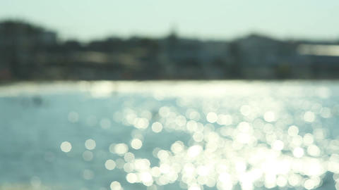 Sparkling fresh wavy water is shining on a sunny summer day , abstract blurry Footage
