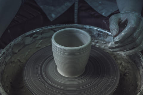 Creating ceramic products of white clay close-up Photo