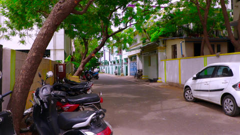 Indian empty street motorbikes and cars parking outside, pan house exterior shot Footage