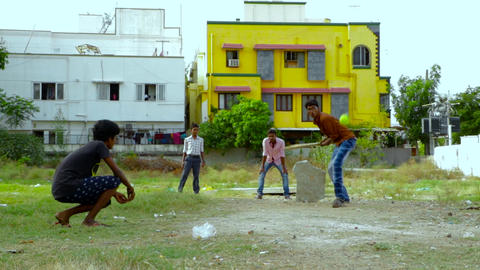Young men play cricket inside park at evening cool time Footage