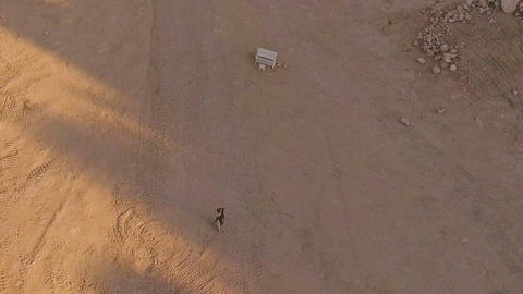 enchanted girl walks through the desert to the white piano. A strange dream Footage