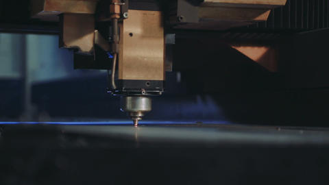 CNC Laser Cutting Metal Steel on a Lathe with the Modern Industrial Technology Live Action