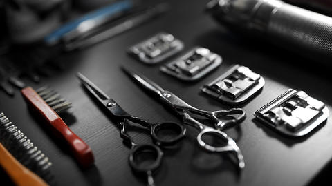 Table with scissors and trimmers at the barber shop, making of haircuts Footage