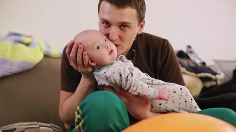 Young father holding new baby living room at home Footage