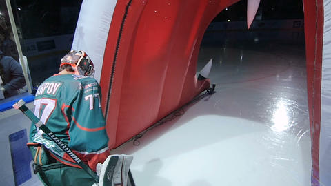 slow motion at colorful lights hockey player speeds to arena Live Action