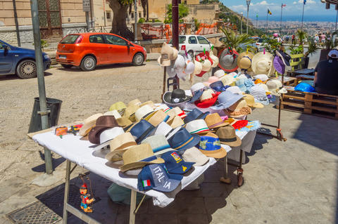 Small shop with two tables selling hats and caps in the city of Photo