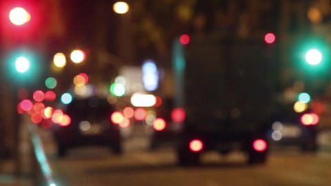 Blurred night traffic scene with traffic light changes.Time Lapse Live Action