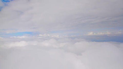 Layers of thick clouds viewed from airplane, gaining altitude, travelling by air Footage