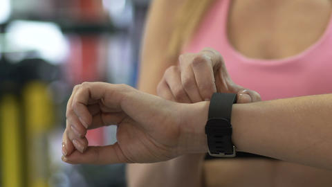Female setting up smart watch before working out in gym, active lifestyle ライブ動画