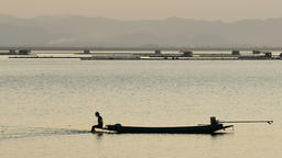 Fisherman on fishing boats in reservoir, Thailand Archivo