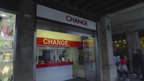 Service building for currency exchange in city street, hectic urban life, money Footage