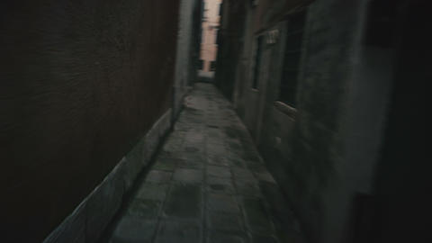 Scared sleepwalking person running along narrow street trying to find exit Footage