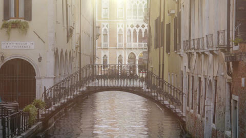 Arch bridge between buildings over narrow channel, beautiful architecture around Footage