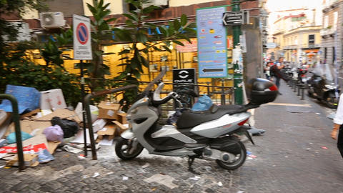 Heaps of garbage lying in streets of Naples, waste management crisis in city Footage