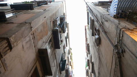 View of narrow passage between high walls of houses in Naples street, Italy Live Action