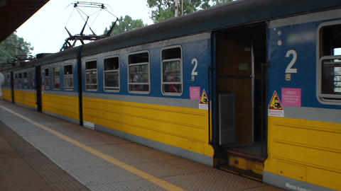 City train waiting for passengers at railway station, suburban transportation Footage