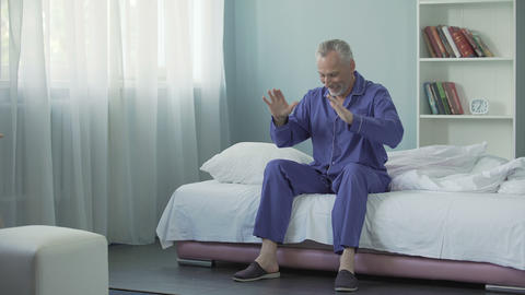 Mature man waking up in fine mood and feeling full of energy and cheerfulness Footage