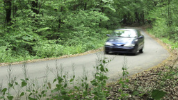 Rally car which rids the green beech forest on the road with many curves 22 Footage