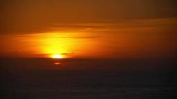 Sunrise at the seashore dark orange sun coming out of the sea 46s Footage