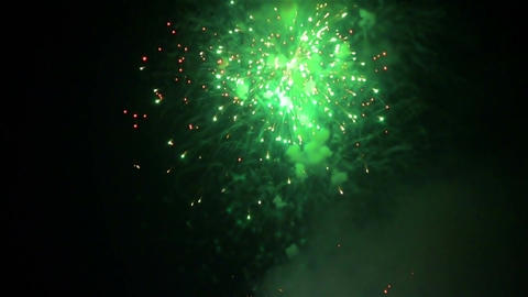 Wide shot of colorful crackers bursting at the sky during festival Footage