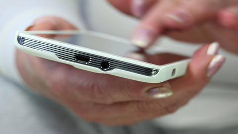 Closeup of woman hands with white smartphone Footage