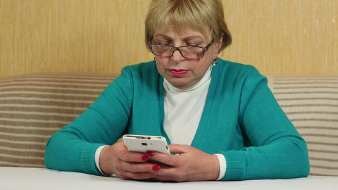 Woman types sms on her mobile phone. Woman with white smartphone Footage