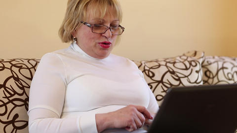 Blonde woman communicates via laptop. Woman with notebook Footage