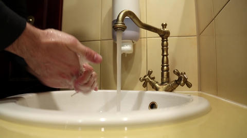 Man washes hands with soap Footage