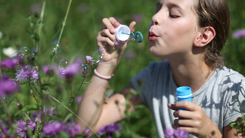 Pretty girl blowing soap bubbles Footage