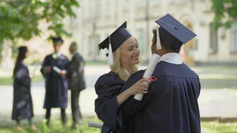 College graduates having conversation, hugging each... Stock Video Footage