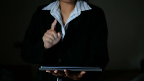 Business woman using tablet dark and grain processed GIF