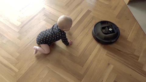 Kid versus Robot Vacuum Cleaner Footage