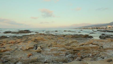 Stone coast in the background of a picturesque sea landscape. Wild stone beach Footage