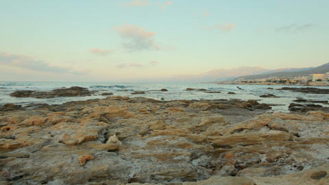 Stone coast in the background of a picturesque sea… Stock Video Footage