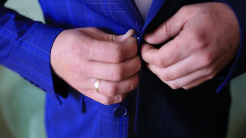 wedding, Close-up , hands of the groom buttoning the jacket Footage