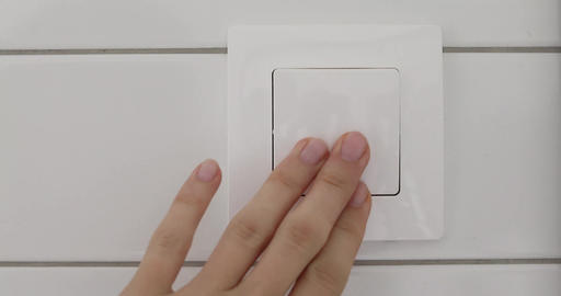 Hand with finger on light switch Footage