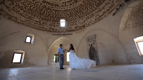 Beautiful and happy bride and groom in an old castle on their wedding day Live Action