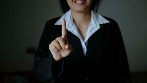 Business woman make hand gesture for technology concept dark and grain processed GIF